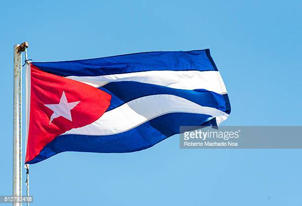 Colorful Cuban flag waiving high in the air beautiful red white blue colors