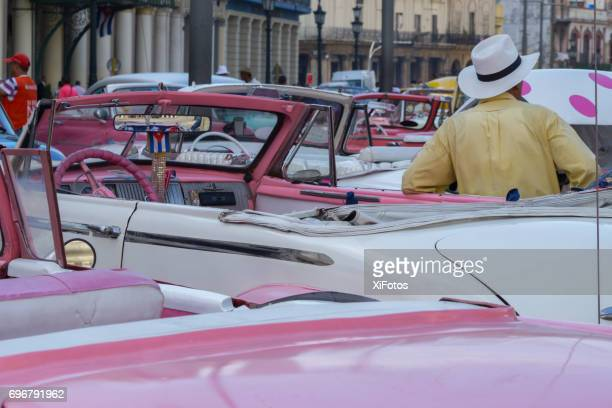 colorful cuban vintage cars - cuban revolution stock photos and pictures