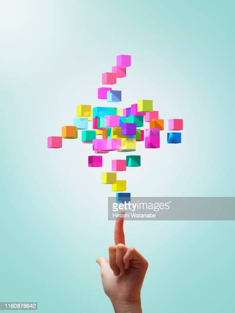 colorful cubes forming geometric shapes with girls hands - skill stock pictures, royalty-free photos & images