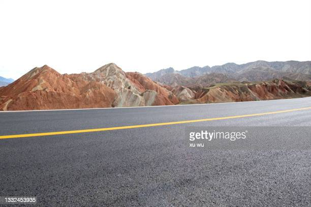 colorful danxia beside the highway in gansu - 甘粛張掖国家地質公園 ストックフォトと画像