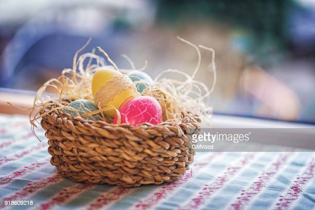 colorful decorated easter eggs in a nest - easter egg foto e immagini stock