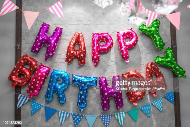 colorful decoration hanging on wall during birthday - bunting stock pictures, royalty-free photos & images