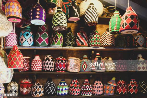 colorful decorations on shelf for sale in store - helena price stock-fotos und bilder