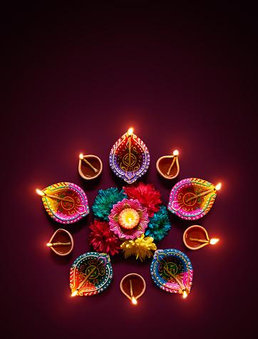 Colorful diya lamps lit during diwali celebration 811762530