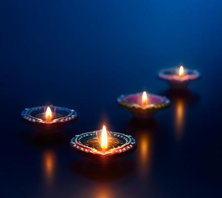 Colorful diya lamps lit during diwali celebration 969343084