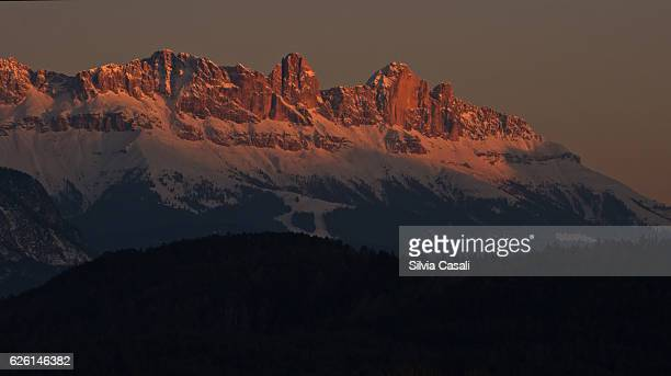 colorful dolomites at sunset with snow - silvia casali stock pictures, royalty-free photos & images
