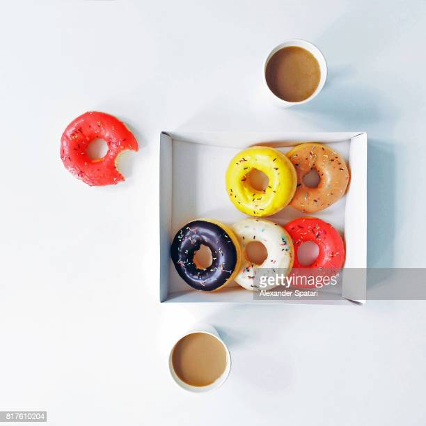 Colorful donuts in a box, high angle view