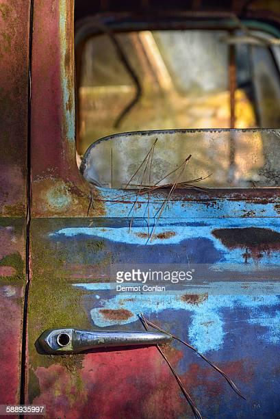 Colorful door of abandoned truck