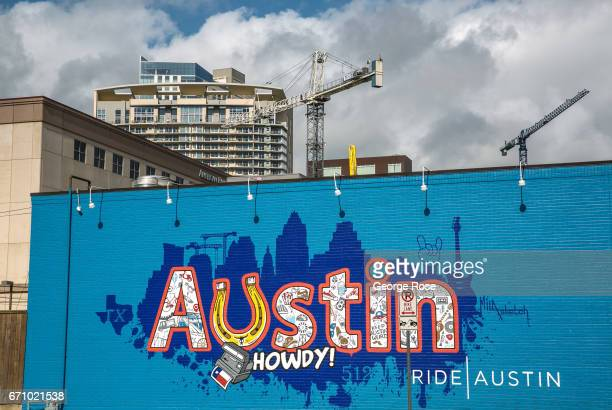 A colorful downtown wall mural sits in the shadow of new highrise construction on April 14 in Austin Texas Austin the State Capital of Texas the...