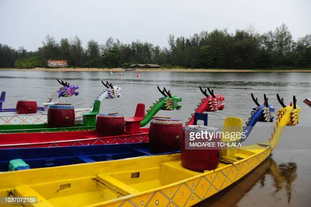 Colorful dragon boats are prepared for competition during a dragon boat festival in Thailand's southern province of Narathiwat on September 21 2018...