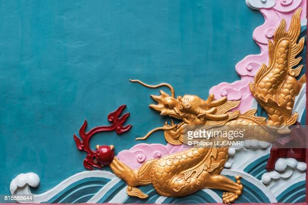 colorful dragon fresco in a buddhist temple - dragon stock photos and pictures