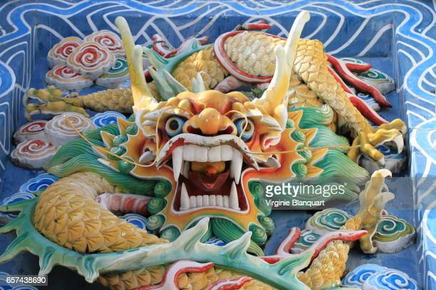 Colorful dragon sculpture at Thean Hou Temple, Kula Lumpur, with offering in its mouth.