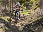 http://www.istockphoto.com/photo/colorful-dressed-female-mountainbiker-in-the-carinthian-forests-austria-gm840224484-136904813