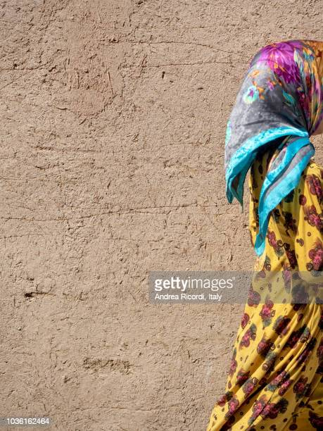 colorful dressed girl in yazd adobe old town, iran - persian girl stock photos and pictures