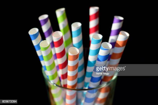 Colorful drinking straws in a glass