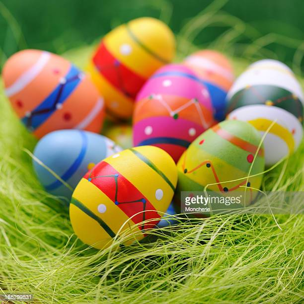 Colorful easter egg nest on green background