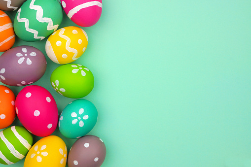 Colorful Easter Egg side border against a turquoise green background 1130538533
