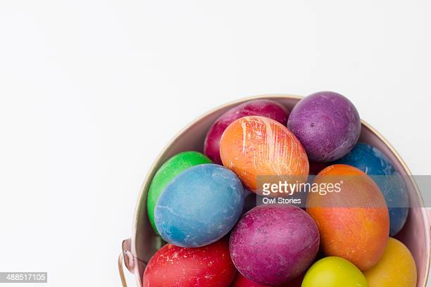 colorful easter eggs in a metal bucket - greek easter stock pictures, royalty-free photos & images