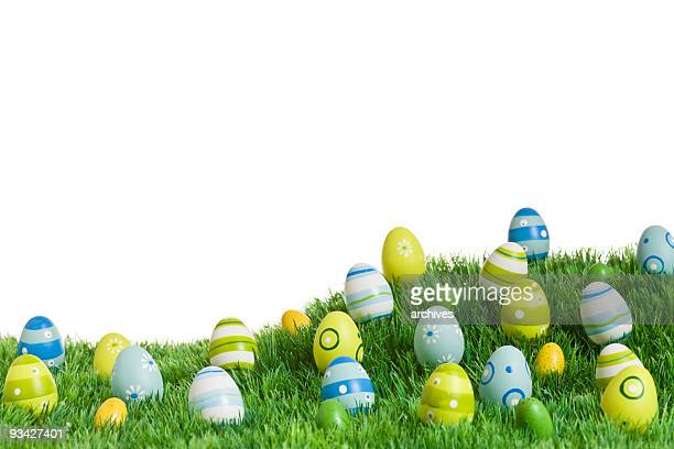 colorful easter eggs in grass - easter religious background stock pictures, royalty-free photos & images