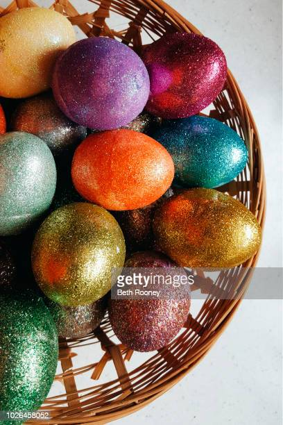colorful easter eggs - easter basket stock photos and pictures