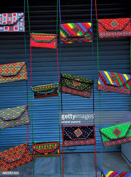 colorful embroidery handicraft, handbags and purses at market for sale - art of india - embroidery stock pictures, royalty-free photos & images