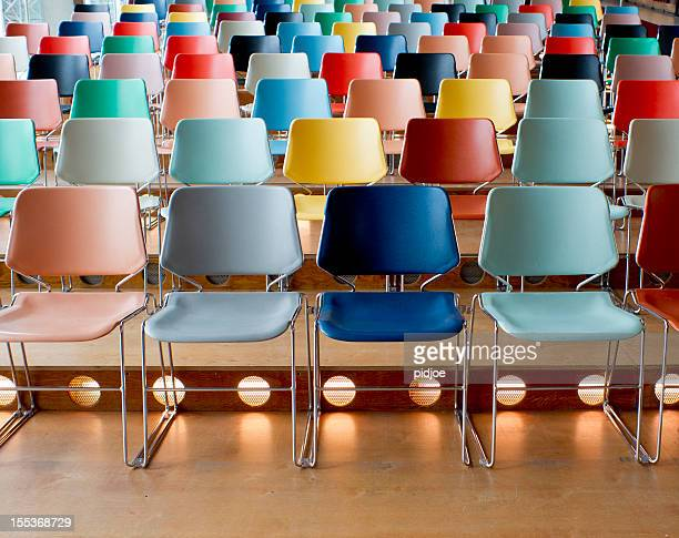 colorful empty chairs in theater - chair stock pictures, royalty-free photos & images