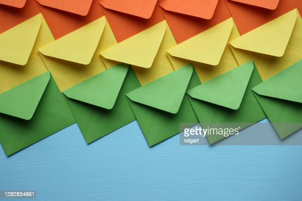 colorful envelopes on blue background - e mail inbox stock pictures, royalty-free photos & images