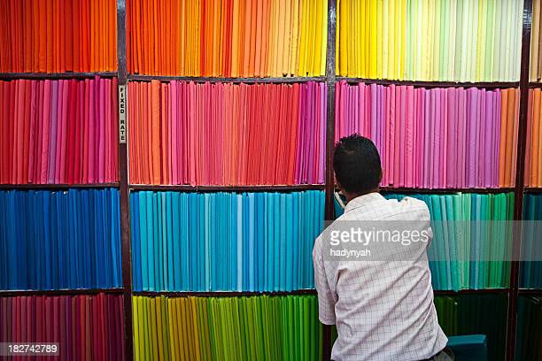 colorful fabrics - textile industry stock pictures, royalty-free photos & images