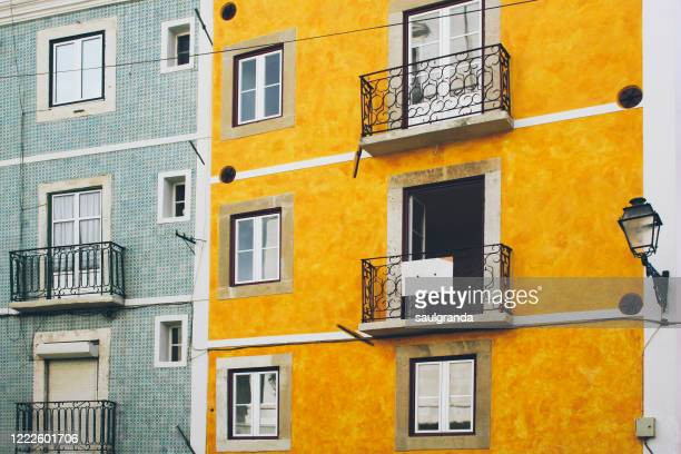 colorful facades in lisbon - traditionally portuguese stock pictures, royalty-free photos & images