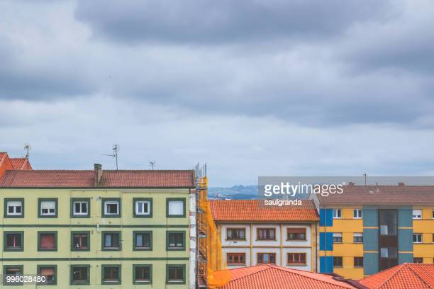 Colorful facades with stormy clouds