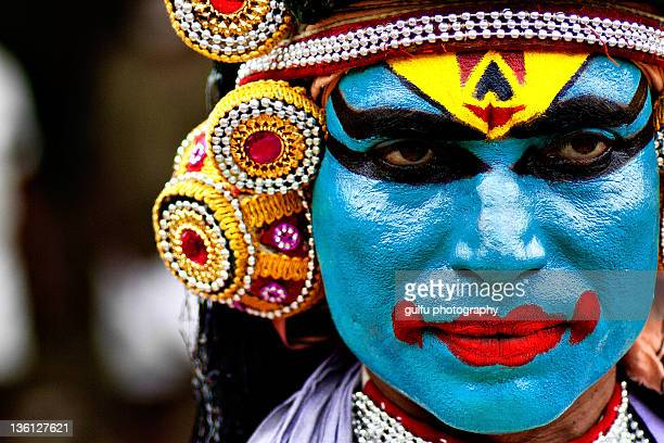 colorful face-mayilattam artist - kochi india stock pictures, royalty-free photos & images