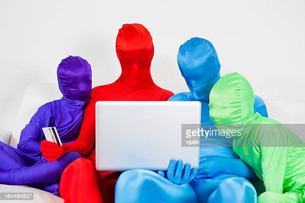 colorful family online shopping at home. - bodysuit stock pictures, royalty-free photos & images