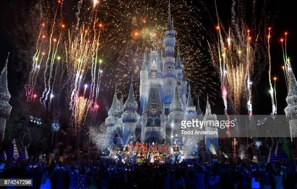 CELEBRATION Colorful fanfare and stunning holiday lights envelop Cinderella Castle at Magic Kingdom Park in Lake Buena Vista Fla Sunday Nov 5 during...