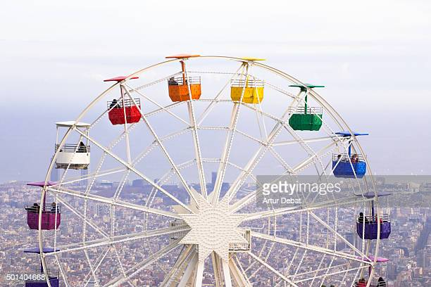 colorful ferris wheel in the tibidabo amusement park mountain with the barcelona city view. - tibidabo stock pictures, royalty-free photos & images