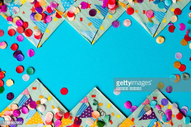 colorful festive confetti flat lay background frame card for birthday party, festival or carnival. - birthday stock pictures, royalty-free photos & images