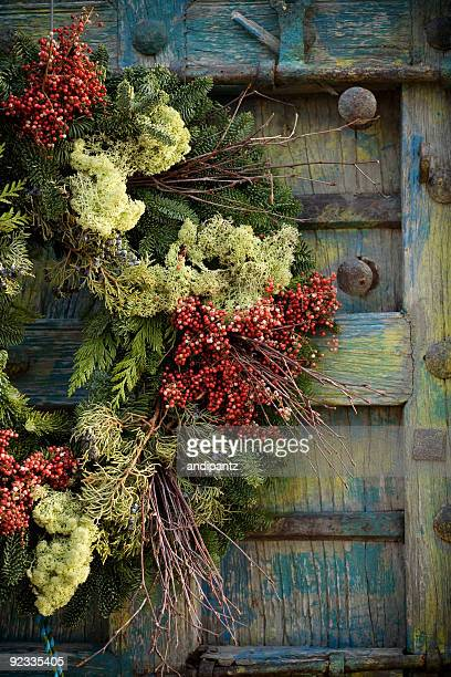 Colorful festive holiday wreath on an antique door