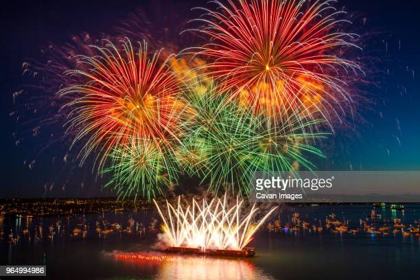 colorful fireworks at english bay against sky - english bay stock photos and pictures