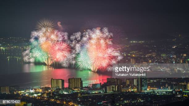 Colorful fireworks over illuminated cityscape, Japan