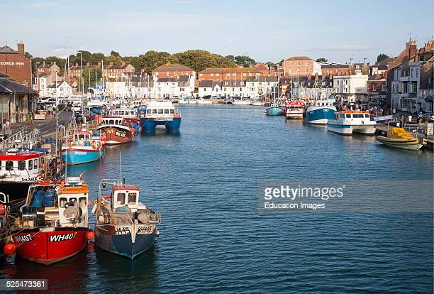 Colorful fishing boats in the harbor at Weymouth Dorset England