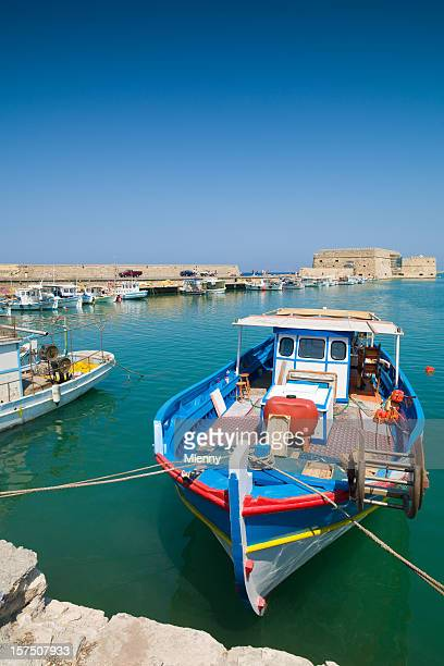 colorful fishing boats iraklion harbor crete - herakleion stock photos and pictures