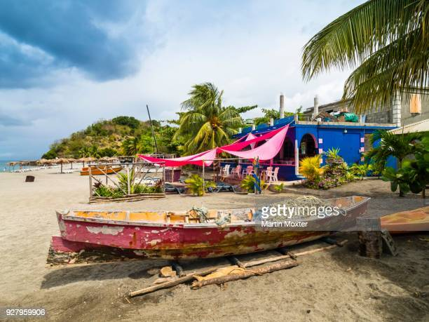colorful fishing boats, mero, department guadeloupe, dominica - dominica stock pictures, royalty-free photos & images