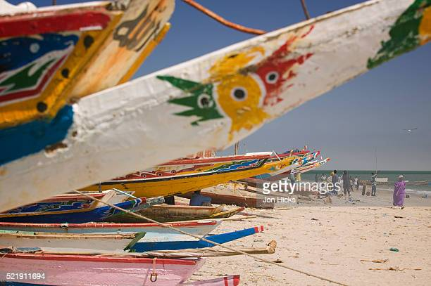 colorful fishing boats on beach - gambia - fotografias e filmes do acervo