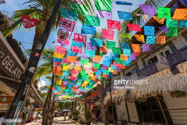 colorful flags in the town of sayulita in mexico - jalisco state stock pictures, royalty-free photos & images