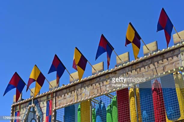 colorful flags on children playground castle - rafael ben ari 個照片及圖片檔