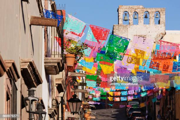 colorful flags on san miguel de allende street, guanajuato, mexico - mexico stock photos and pictures