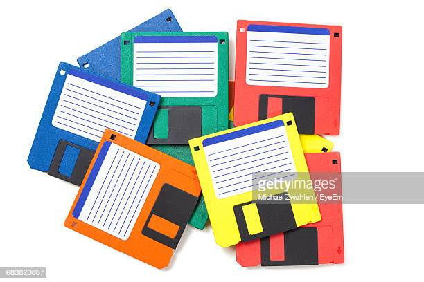 Colorful Floppy Disks Over White Background