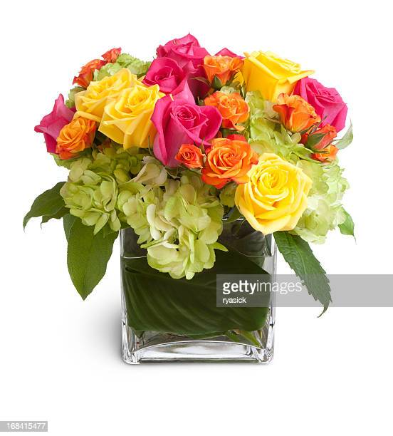 Colorful Floral Arrangement in  Square Glass Vase Isolated