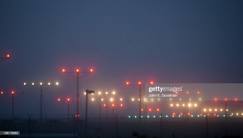 Colorful Fogbound Landing Lights Guide Airplanes Stock Photo