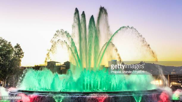 colorful fountain against sky - tibidabo stock pictures, royalty-free photos & images