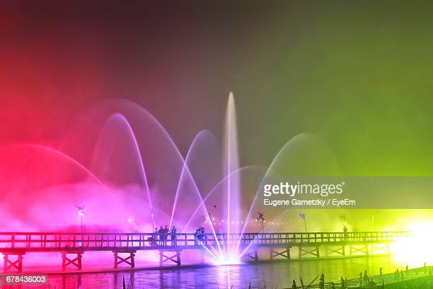 Colorful Fountains At Night During Tomorrowland